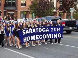 The front of the homecoming parade rounds the corner onto Lake Avenue and towards Broadway.