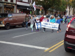 Lake Avenue Elementary School students march in the parade on Broadway.