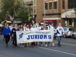 Saratoga Springs High School juniors make their way down Broadway.