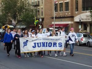 Saratoga Springs High School juniors make their way down Broadway.