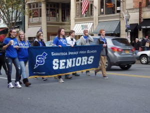 Students from the class of 2015 make their way down Broadway ahead of their float.