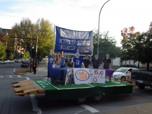 The class of 2016 float turns the corner from Broadway onto Congress Street during the parade.
