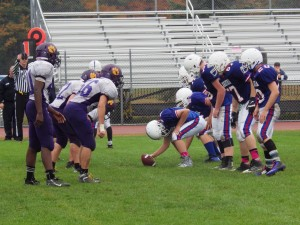 Saratoga center Kyle Vanyo prepares to hand off during Saturday's game.