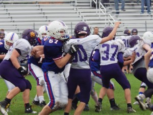 Saratoga tackle Cody Moore grabs Ballston Spa's Vincent Miczek during Saturday's game.