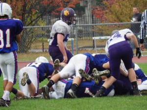 A Saratoga defensive pileup during Saturday's game.