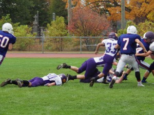 A Blue Streaks run leaves behind a trail of Scotties during Saturday's game. Saratoga's running game helped them post a shutout victory over Ballston Spa.