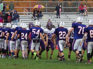 The teams line up after the game. Saratoga won 32-0.