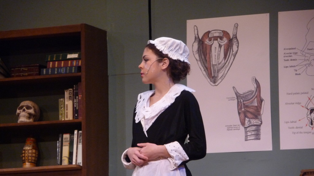 Emily Sayer (as Mrs. Pearce) rehearses for Pygmalion Wednesday.