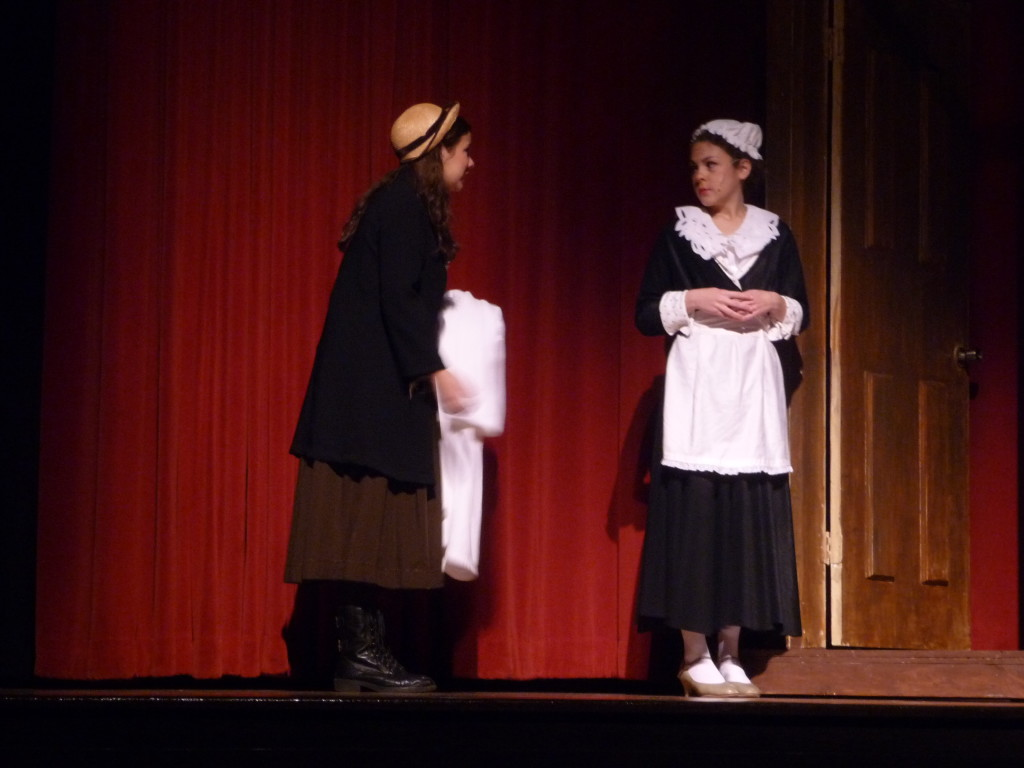 Carolyn Shields (as Eliza Doolittle) and Emily Sayer as (Mrs. Pearce) rehearse for Pygmalion Wednesday. The show runs beginning Friday, Nov. 7.