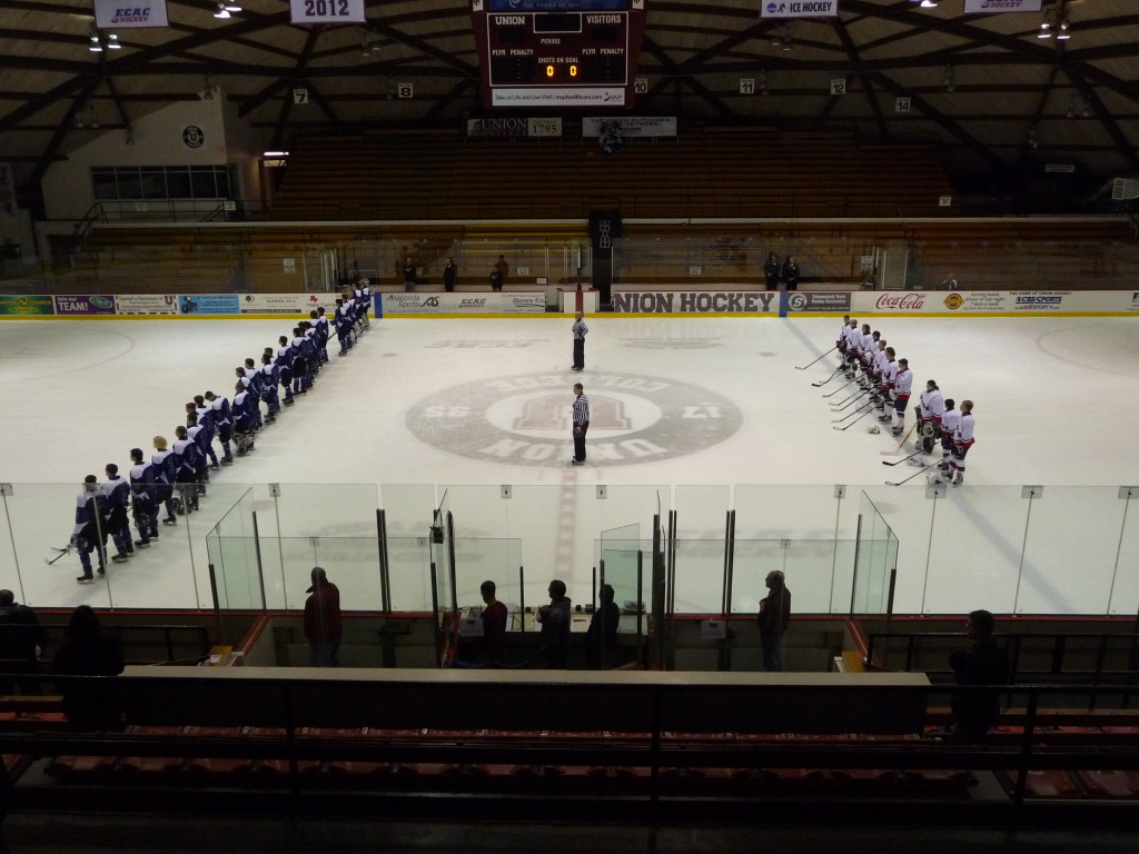The teams line up during the national anthem before the game's start. Saratoga has 26 players on their roster compared to the Storm's 11.