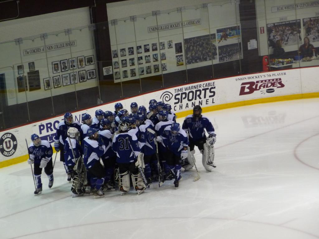 Saratoga's team huddle before the game.