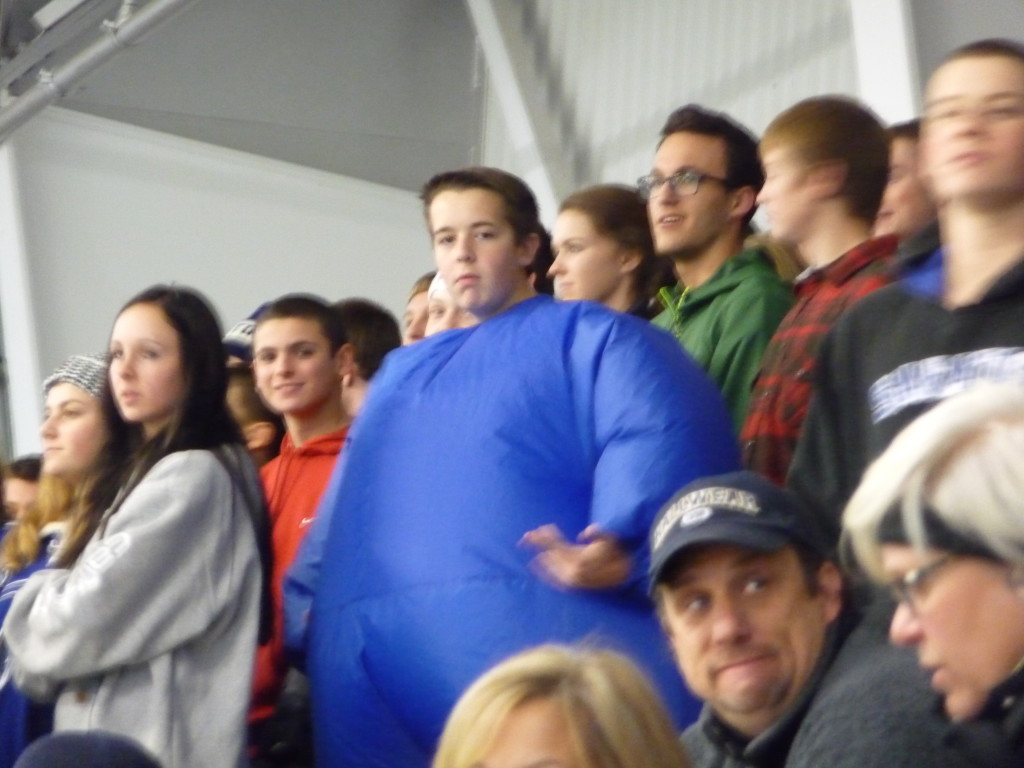 Kevin Powers '16 wore an air-filled blue suit in the student section at Friday's game.