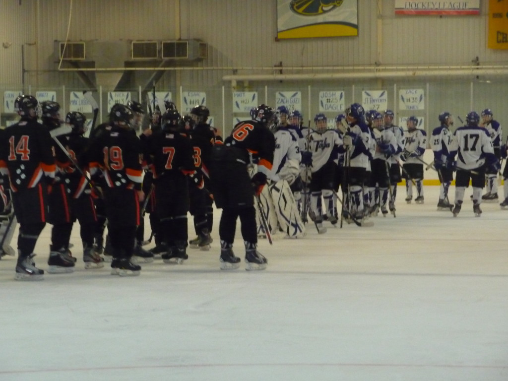 The teams line up after Friday's game. Saratoga lost in their home opener to Mamaroneck, 4-3.