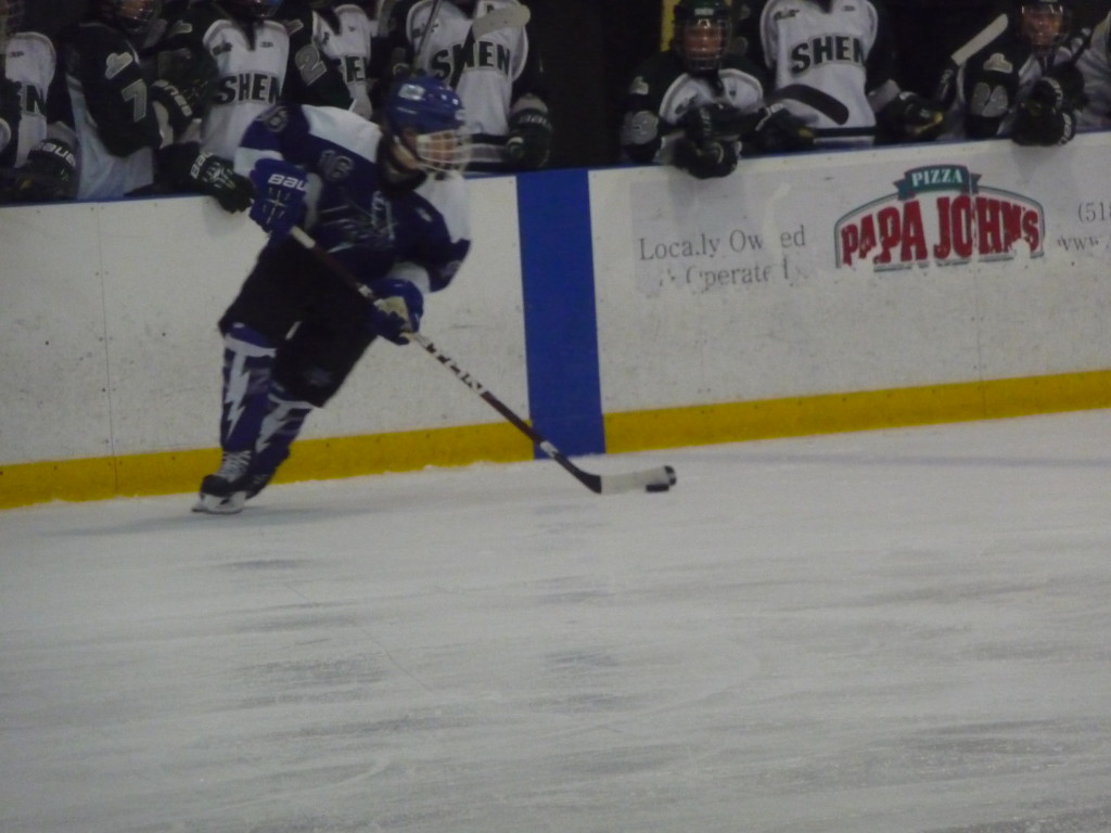 Saratoga's Cam McCall '15 skates with the puck during the second period of Wednesday's game.