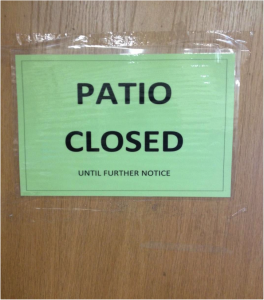 Signs like this one posted on the cafeteria doors keep students out of the north courtyard patio. Lis Barreto / The Lightning Rod