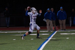 Saratoga quarterback Brian Williams makes a pass during Friday's game.