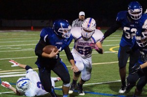 La Salle fullback Bayley Haskin advances the ball past Saratoga guard Austin Degener. Sam Cherubin for The Lightning Rod